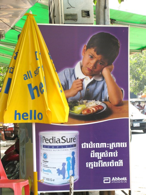 PediaSure ad outside drug store, Phnom Penh, Cambodia