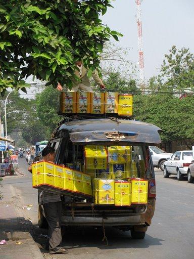 Loading up the minivan, Phnom Penh, Cambodia